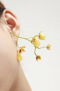 woman's ear with flower
